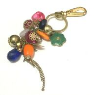 Great NEXT fun gold tone metal key ring various coloured beads and charms