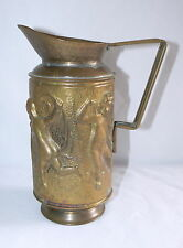 Vintage Brass Pitcher Raised Cherub Scene 8 1/2 Inches High.