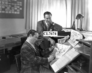 Walt Disney and Ward Kimball with Sketches of Mad Hatter for Alice in Wonderland