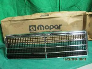 81 82 83 84 Plymouth Reliant Chrome & Plastic Grill Piece NOS MOPAR 4103355