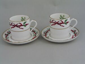 TWO ROYAL WORCESTER HOLLY RIBBONS DEMITASSE COFFEE CUPS/CANS AND SAUCERS.