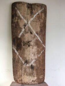 Papua New Guinea tribal fighting shield. 1.45m x .62m