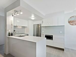 kitchen cabinets in an L shape with island