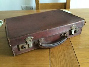 """Antique small brown leather suitcase measures 14"""" x 9""""."""