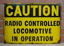Old Porcelain CAUTION RADIO CONTROLLED LOCOMOTIVE IN OPERATION Sign Railroad RR