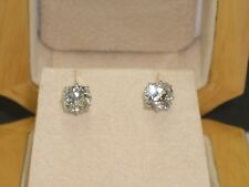 2.00 ct (total) Old Cut Cushion Radiant Diamond Earrings, Mounted in Platinum.
