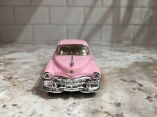 1953 Cadillac series 62 diecast toy car collectible color pink