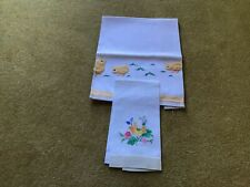 A LARGE TEA TOWEL AND A LINEN GUEST HAND TOWEL