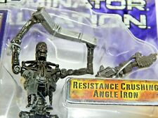 TERMINATION SALVATION FIGURINE, T-700, WITH GUN AND PIECE OF ANGLE IRON