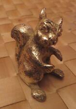 Écureuil en métal argenté – traces d'usage