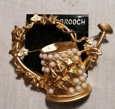 gold tone watering can with opal like stones brooch for your gardening friends