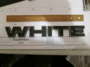 12 INCH WHITE MOTOR CO. TRUCK EMBLEM HAS THE NUMBER 02-7017130 AN UNDER THAT DSI