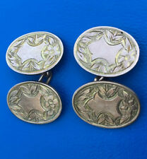 A Pair Of Oval 9ct Gold Cufflinks With Flower Decoration And Cartouches