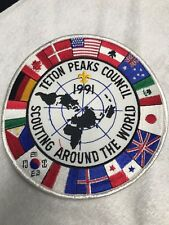 BSA TETON PEAKS COUNCIL JACKET PATCH 1991 SCOUTING AROUND THE WORLD MINT RARE!