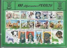 Conjunto de 100 Sellos usados diferentes del tema: PERROS.