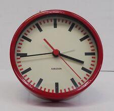 Älterer roter elektromechanischer Karlsson Wecker Bahn Design Uhr