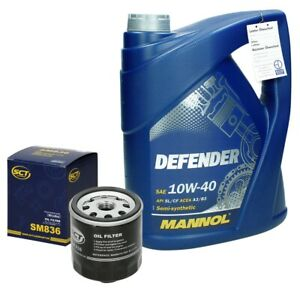 Ölfilter Motorölfilter + 5 Liter Mannol Defender 10W-40 Audi Seat Skoda VW