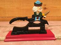 Vintage Cast Iron Painted Soldier Nut Cracker Mounted on Wood Base.           A3