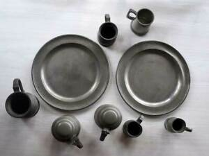 Antique pewter plates, jugs & glass-bottomed tankards
