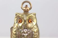 OWL DOUBLE SOVEREIGN BRASS CASE GLASS EYES