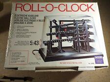 Horloge a billes, Roll o Clock Dexim en boite sans notice à réparer.