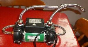 SALAMANDER TWIN BATHROOM SHOWER PUMP WITH HOSES. RSP50. 1.5 BAR. FULLY WORKING.