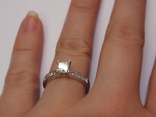 14 kt WHITE GOLD RING with WHITE PRINCESS CUT DIAMOND