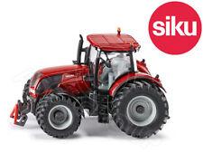 Tracteurs miniatures rouges en plastique