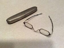 Vintage wire rim eyeglasses in silver embossed case