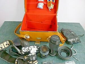 Job Lot Camera, lenses, straps, filters and large bag.