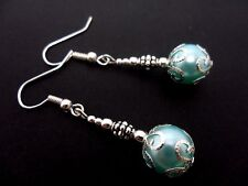 A PAIR OF DANGLY BLUE GLASS BEAD  SILVER PLATED DROP EARRINGS.