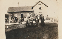 VINTAGE POSTCARD EARLY REAL PHOTO CARD FAMILY ON A FARM - ANTIQUE