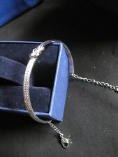 Swarovski Silver Knot bangle with the Swan Logo