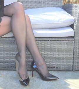 worn glossy black vintage sheer nylon stockings medium