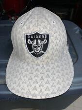 Nice Oakland / Las Vegas Raiders Hat Cap Reebok NFL Size 7 1/4 White w/ Pattern