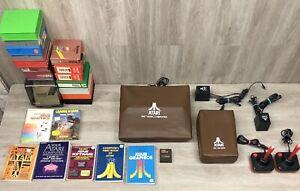 Atari 800 Computer with 1050 Disk Drive, (2) Joysticks, Books, Manuals, & Games