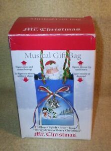 """2011 MR. CHRISTMAS MUSICAL GIFT BAG WIND-UP PLAYS """"WE WISH YOU A MERRY CHRISTMAS"""