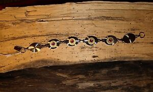 Silver Tone Bullet Bracelet. Comes with 4 Brass 38's  w/wo crystals B-408