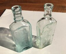 Vintage Lot Of 2  raised-lettering bottle: RAULEIGH'S Antique Glass