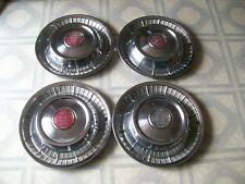 """1957  15""""  BUICK   HUBCAPS / SET OF  FOUR"""