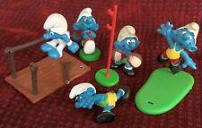 Vintage smurf figures, five sportsmen