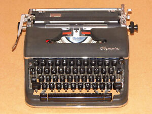 Olympia De-Luxe SM4, rare black / dark colour  typewriter, Made In West Germany