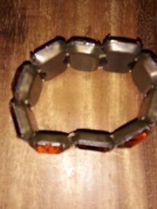Beautiful Amber Coloured Plastic Bracelet