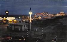 uk4557 car palace pier by night brighton  uk