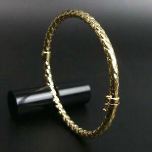FINE 9 CT GOLD SPRING HINGED BANGLE - 6.4 GRAMS