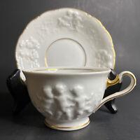 Antique Von Schierholz Embossed Cherub  Figures Demitasse Cup Saucer RARE