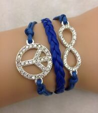 Bracelet strass bleu marine Peace and Love et lien infini en strass