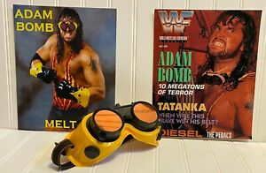 Reproduction autographed WWF Adam Bomb Goggles and (2) 8X10 Adam Bomb photos.