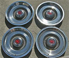 """4--14"""" HUBCAPS -'75-'78 VARIOUS FORD & MERCURY MODELS, RIBBED W/RED CENTERS"""