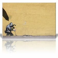 Canvas Print - Camera man pulls flower to film better - Street Art - 24 x 36